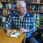 "Armistead Maupin signs his book, ""The Days of Ana Madrigal,"" at Book Passage, SF Ferry Building. Photo by BF Newhall"