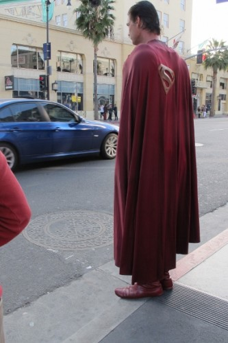 Actor Christopher Dennis on curb of Hollywood Boulevard dressed as Superman. Photo by BF Newhall