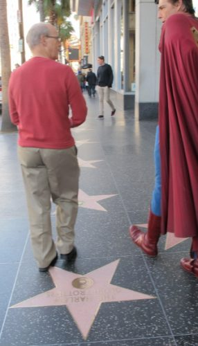 Actor Christopher Dennis in Superman outfit strolls along the Hollywood Walk of Fame with Jon Newhall. Photo by BF Newhall