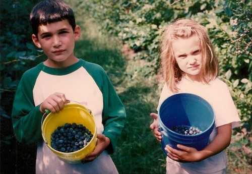 Two children show off the buckets of blueberries they've picked in Michigan. Photo by BF Newhall
