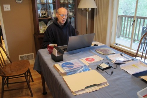 Jon Newhall, the author's geeky husband, sets up her new Toshiba laptop. Photo by BF Newhall