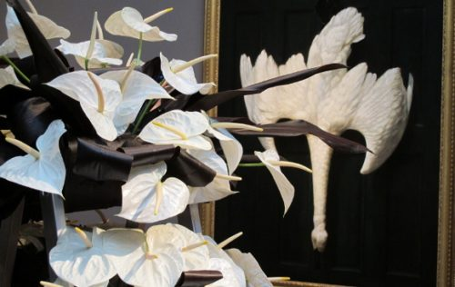 Rhonda Stoffel created a bouquet of white anthuriums in response to  Alexander Pope's black and white painting of dead swan. Photo by BF Newhall