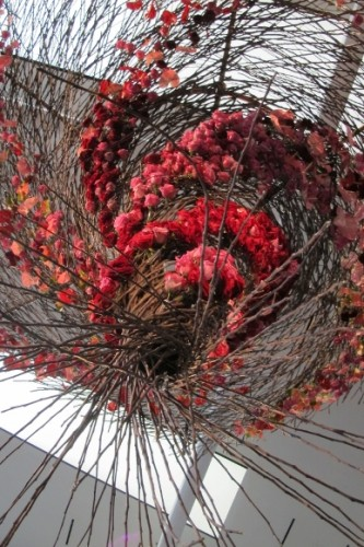 From Waterlily Pond Floral Design Studio, San Francisco, an aeriel design of twigs and red blossoms. Photo by BF Newhall