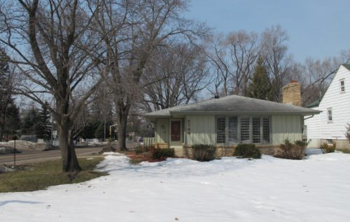 Midcentury traditional house with snow and bare trees in Edina, a subub of Minneapolis. Photo by BF Newhall