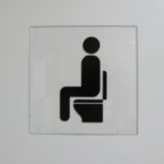 A symbol in the lavatory of Shanghai airport indicating a Western-style sit-down toilet. Photo by BF Newhall