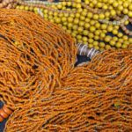 Orange and yellow beaded necklaces from the Himalayas were selling for $5 to $20 at the Himalayan Fair in Berkeley, CA, 2014. Photo by BF Newhall