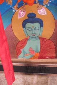 A thangka depicting a Buddha with blue skin at Himalayan Fair Berkeley. Photo by BF Newhall