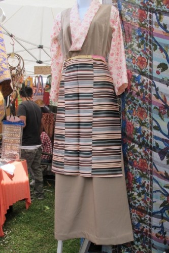 Tibetan traditional flowered blouse, silk skirt and heavy silk striped apron, $95 at the Himalayan Fair Berkeley, 2014. Photo by BF Newhall