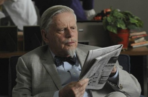 Actor Robert Morse reading newspaper as Bert Cooper in the Mad Men TV series