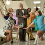 robert morse in season finale of mad men tv show dances and sings the best things in life are free with four pretty secretaries.