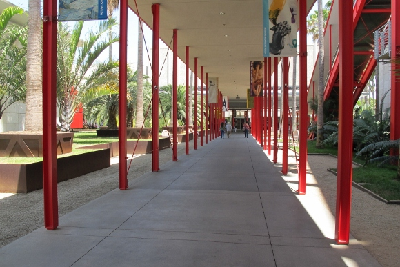 Red poles adorn a walkway at the Los Angeles County Museum of Art. Photo by BF Newhall