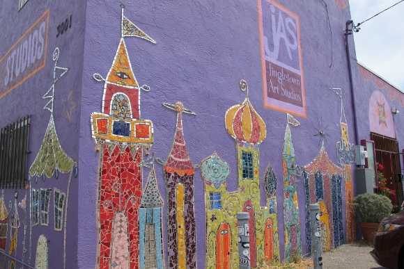 The facade of Jingletown Art Studios in Oakland, CA, is decorated with colorful mosaics of fanciful castles and towers. Photo by BF Newhall