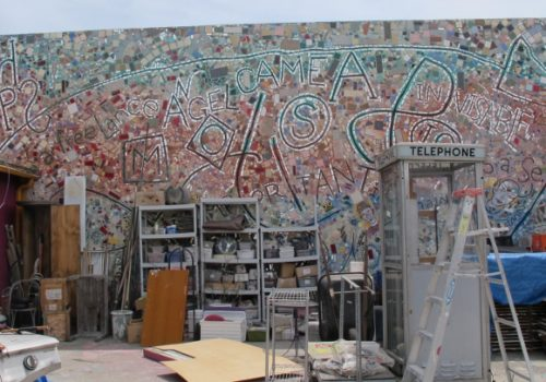 Cluttered courtyard of Jingletown Art Studios, Oakland, CA. Mosaic mural by Philadelphia artist Isaiah Zagar. Photo by BF Newhall