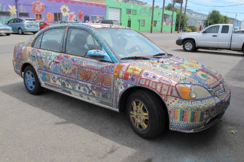 a car entirely covered with mosaics parked in Oakland, CA, Jingletown neighborhood. Photo by BF Newhall