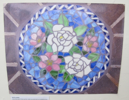 """White Roses"" is a glass mosaic inset with pink and white flowers by Rachel Rodi. Photo by BF Newhall Photo by BF Newhall"