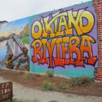 the words Oakland Riviera in bright colors are painted on a wall in Oakland, CA, Jingletown. Photo by BF Newhall