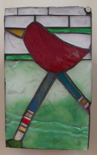 a small mosaic with red bird and green background at Institute of Mosaic Art. Photo by BF Newhall