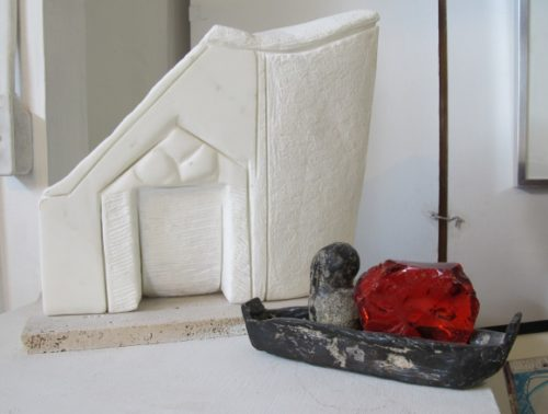 "Left: Patricia Bengtson-Jones' sculpture ""Arcades."" Carrara marble, limestone base. Right:  ""Gnome with Curls on a Voyage."" Iron, cast glass. Photo by Barbara Falconer Newhall."