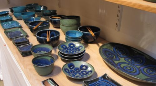 A shelf of Itsuko Zenitani's fine porcelain ceramic blue tableware on display at the Berkeley Potters Guild. Photo by BF Newhall