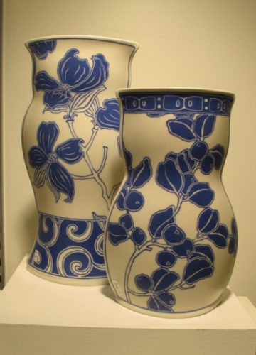 Sarah Gregory ceramics, at Potters Guild, Berkeley, CA. Two white vases w blue floral painting by Sarah Gregory ceramics, at Berkeley Potters Guild, CA. . Photo by BF Newhall