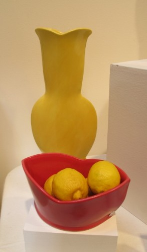 At the  Berkeley Potters Guild, Berkeley, CA, ceramics by Sarah Gregory: A yellow vase,  and a red bowl8. Photo by BF Newhall