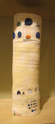 Tall, narrow whmsical handmade ceramic vase, tubular in shape by Dahli Tutman. At the Berkeley Potters Guild, Berkeley, CA. Photo by BF Newhall
