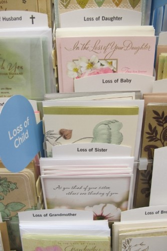 Sympathy, condolence cards on display at Hallmark store. Loss of a child, etc. Photo by Barbara Newhall