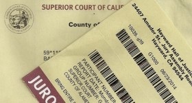 Copy of a jury duty summons and juror badge superior court of california. Photo by BF Newhall