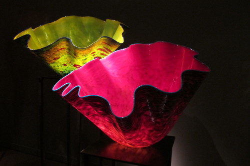 """Two vessels with scalopped edges-- one chartreuse, the other cerise -- in Dale Chihuly's """"Macchia Forest"""" at the Chihuly Garden and Glass in Seattle. Photo by Barbara Newhall"""