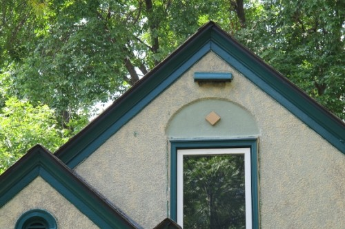 tudor roof with round arch above the window in Minneapolis. Photo by Barbara Newhall