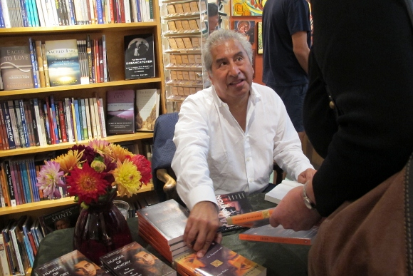 Richard Rodriguez, author of Darling, signs copies of the paperback at Sagrada bookstore, Oakland, CA/. Photo by Barbara Newhall