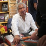 "richard rodriguez signs copies of his book ""Darling"" at Sagrada Sacred Arts, Oakland, CA. Photo by Barbara Newhall"