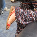 A woman at SFO wears orange sandals and paisley pants. Photo by BF Newhall