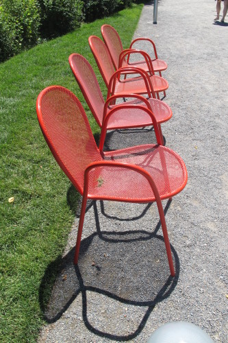 Orange metal chairs in a row at the Olympic Sculpture Park, Seattle. Photo by Barbara Newhall