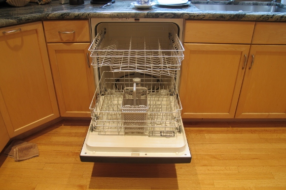 An open 2000 Maytag Jetclean Quiet Plus dishwasher with racks visible that finally wore out after 14 years. Photo by Barbara Newhall