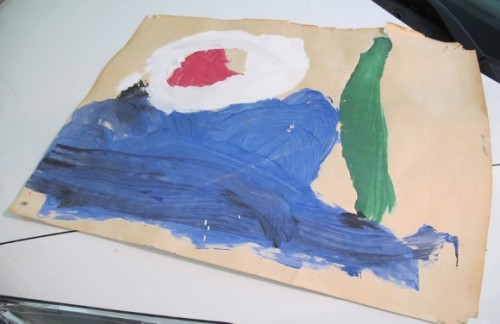 A child's blue green, white and red tempera painting on newsprint. Photo by Barbara Newhall