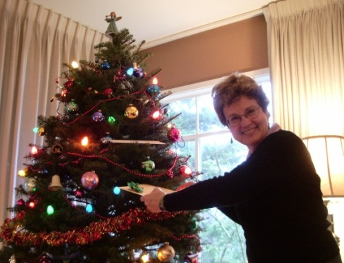 Barbara Falaconer Newhall taking a gift from the family Christmas tree. Photo by Jon Newhall