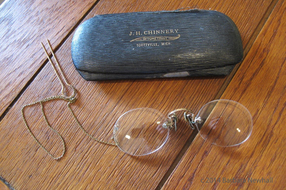 My grandmorther's pince-nez with gold chain, hairpin and laminated metal case from J.H. Chinnery, optometrist, Scottville, Michigan. Photo by Barbara Newhall