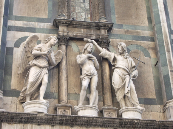"John the Baptist baptizes Jesus in this ""Baptism of Christ"" by Andrea Sansovino (Italian, 1467–1529) and Innocenzo Spinazzi. I photographed the work while it was still on the Battistero di San Giovanni in Florence, Italy. It's now in Florence's  Opera del Duomo Museum."