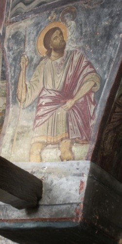 Legend has it that Christopher carried the young Jesus -- and the weight of the world -- to safety across a river. Here in a fresco on the Isle of Patmos, Greece. Photo by Barbara Newhall