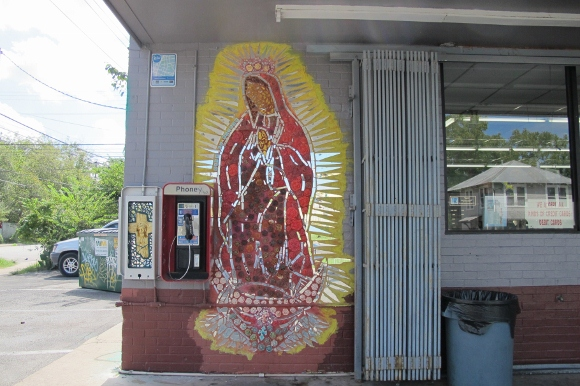 At an Austin, Texas, gas station, an image of Jesus on the cross gets a fraction of the space awarded a mosaic of his mother Mary, the Virgin of Guadalupe. Photo by Barbara Newhall