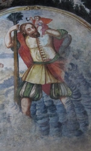 The Catholic Church no longer considers St. Christopher a saint, yet his image exists aroudn the world, this one on a wall of the church at Atotonilco, Mexico. Photo by Barbara Newhall
