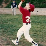 ten year old boy in baseball uniform catches the ball. Photo by Barbara Newhall
