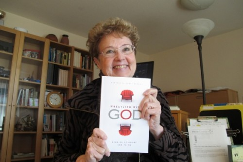 Author Barbara Falconer Newhall joyfully shows off her copy of Wrestling with God with cover design by Michelle Lenger. Photo by Barbara Newhall
