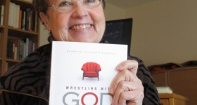 A copy of Barbara Falconer Newhall's paperback book Wrestling with God and the author. Photo by Barbara Newhall
