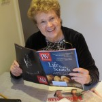 Author Barbara Falconer Newhall opens her copy of Publishers Weekly magazine, which had just arrived in the mail, to find that her book, Wrestling with God, got a starred review in the January 21, 2015, issue. Photo by Jon Newhall