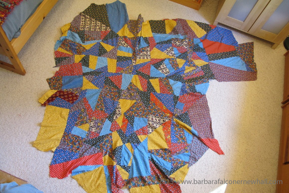 A crazy quilt made of colorful calico is riddled with ripples and waves because the quilter, Barbara Falconer Newhall, failed to stitch the pieces to a flat backing. Photo by Barbara Falconer Newhall