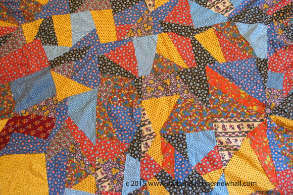 A portion of a crazy quilt made in 1971 by Barbara Falconer Newhall of calico fabrics in primary colors. Photo by Barbara Newhall