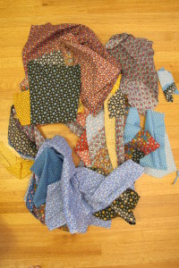Vintage calico scraps from the 1970s in bold primary colors await sewing into a crazy quilt. Photo by Barbara Newhall