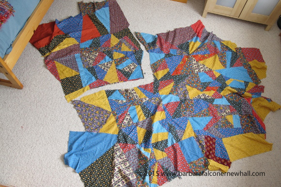 A crazy quilt top cut into pieces to make into smaller quilts. Primary colored vintage calico. Photo by Barbara Newhall